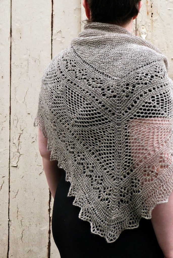 Woman wears a grey lace shawl with plain centre