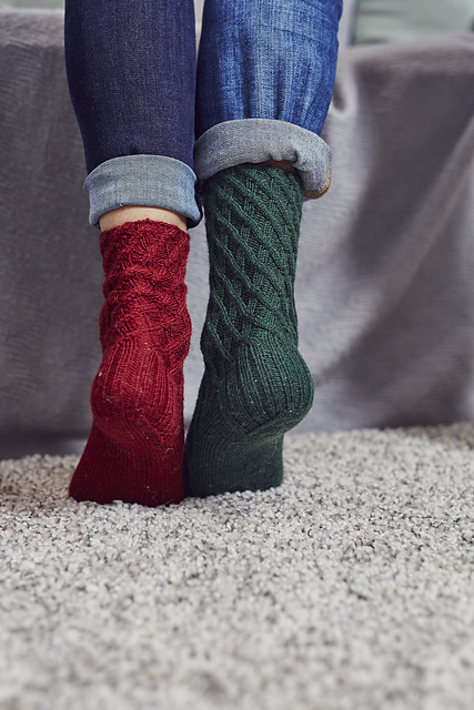 Photo of cabled socks in red and green