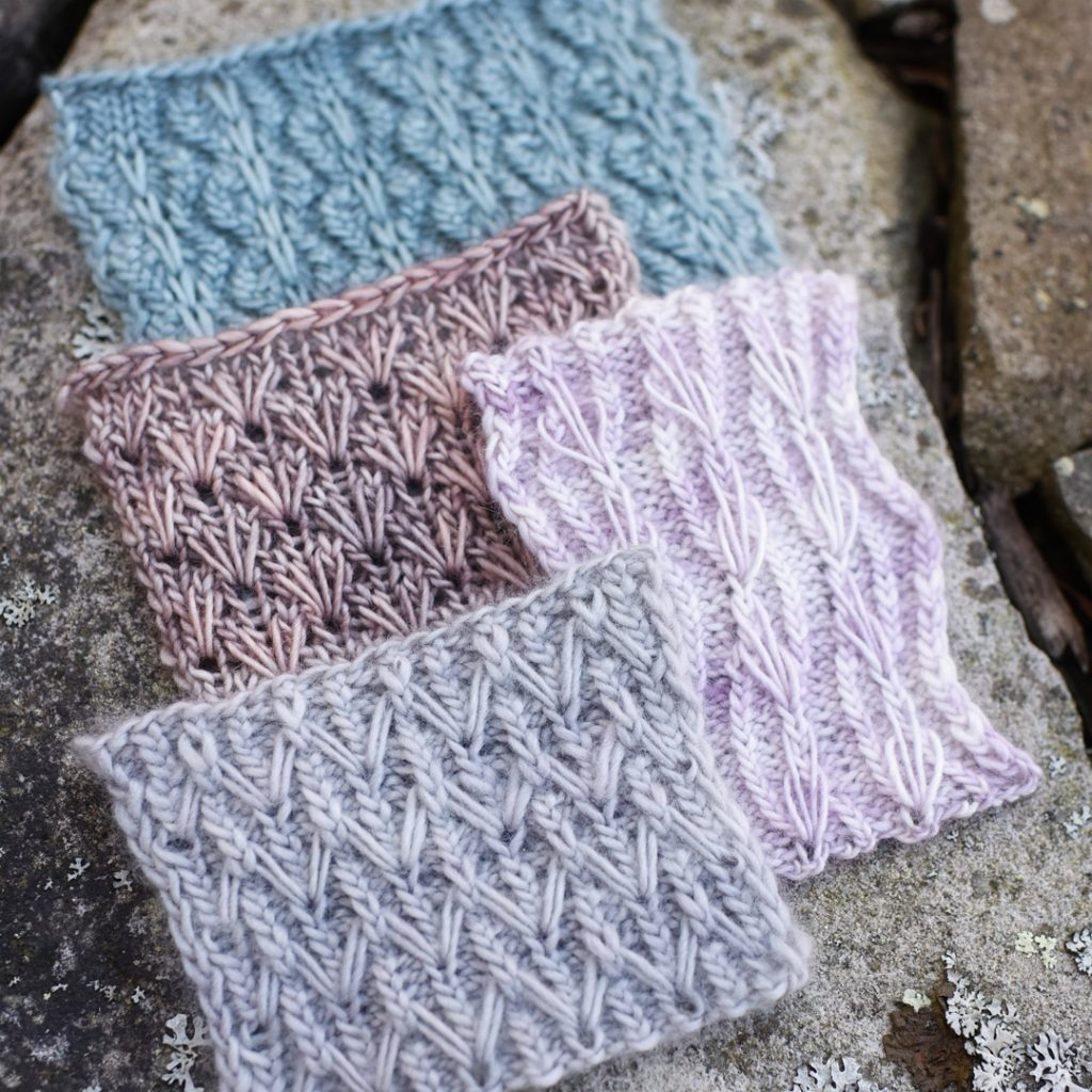 Photo of knitting swatches with different stitch patterns laid on stone