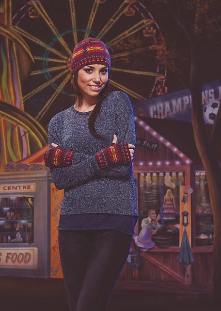 Woman wears blue jumper and purple + orange hat and mitts