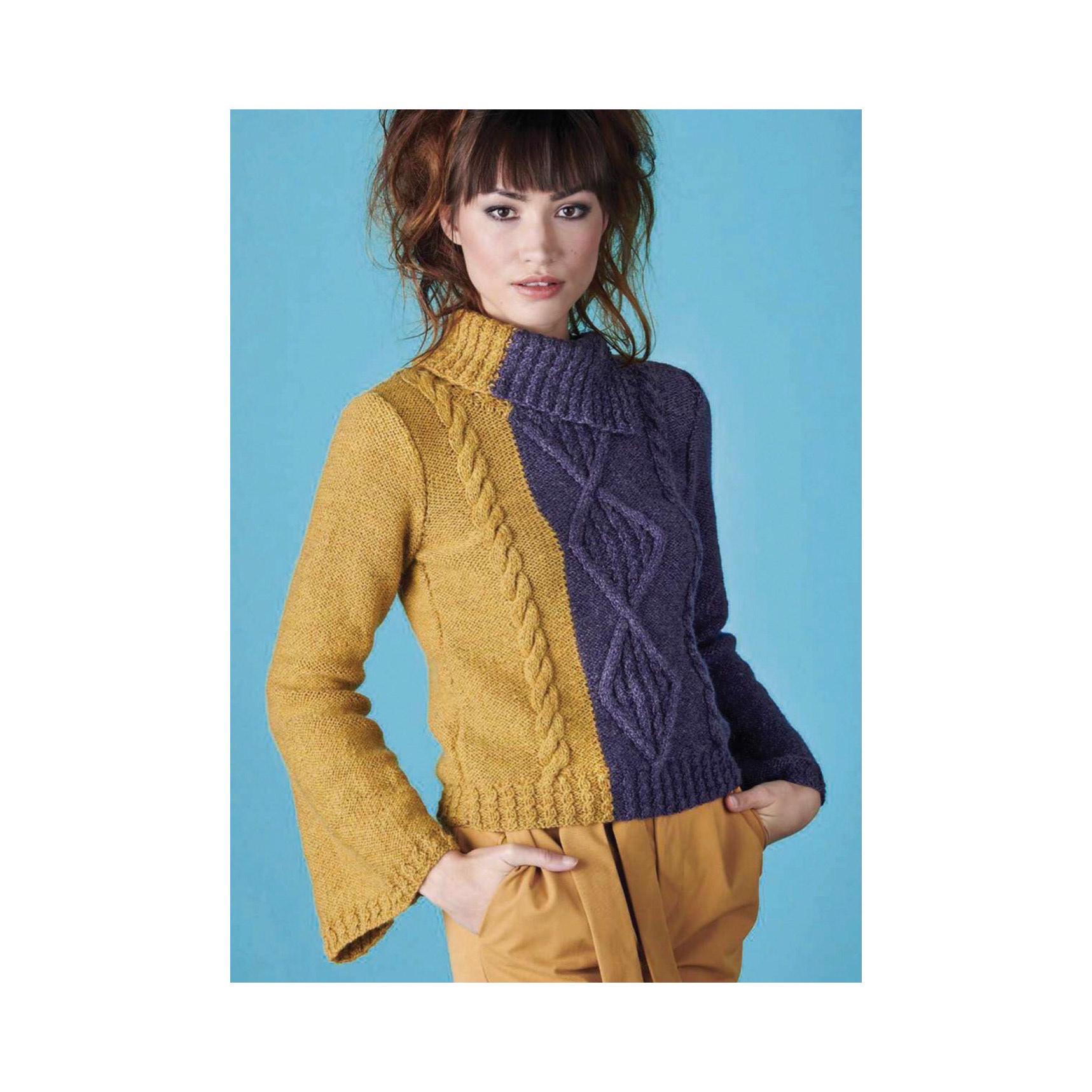 Photo of a woman wearing a knitted jumper with vertical bold cables. The jumper is purple for one sleeve and most of the body, and mustard yellow for the rest.