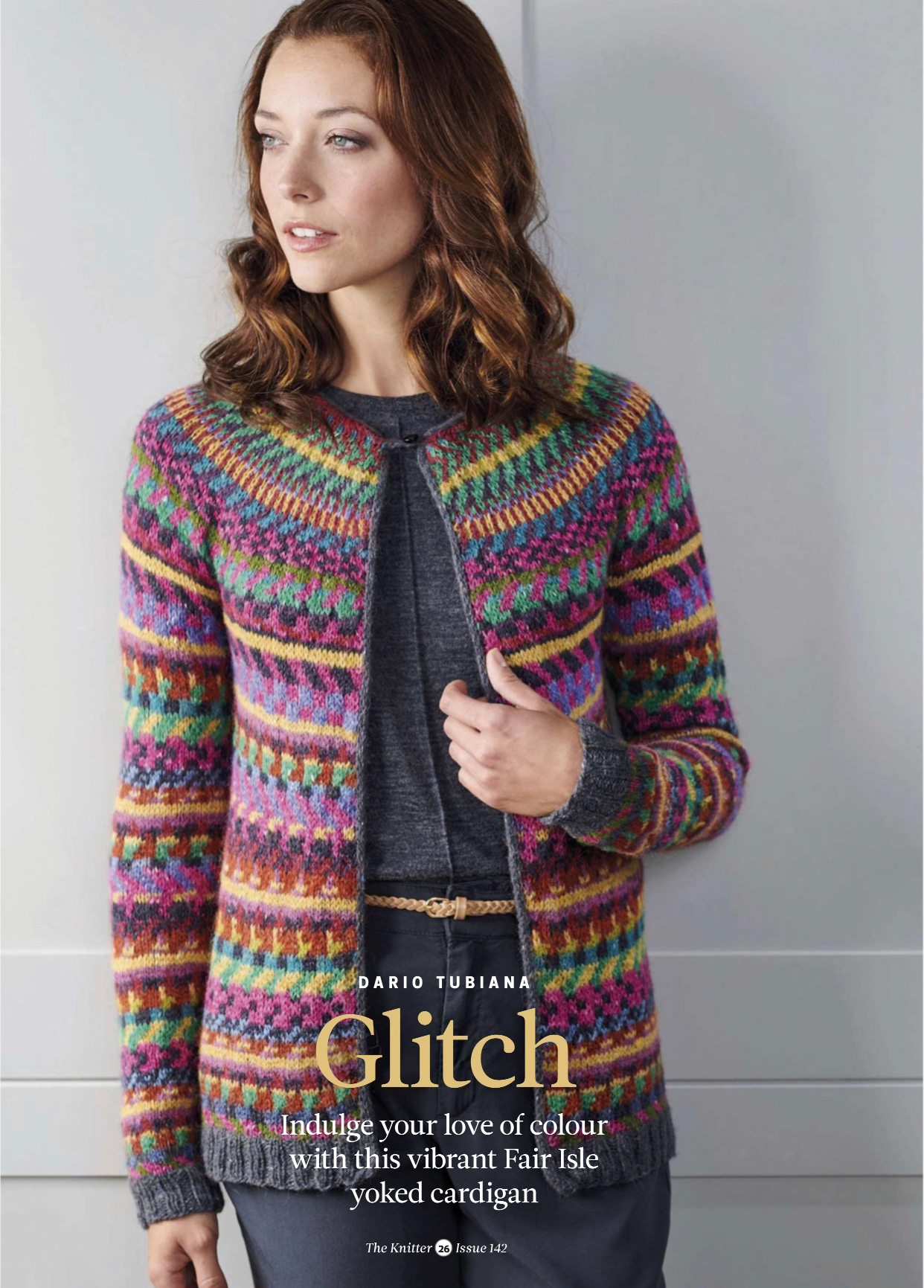 "Photo of a woman wearing a colourwork knitted cardigan. The words ""Dario Tubiana, Glitch, indulge your love of colour with this vibrant Fair Isle yoked cardigan, The Knitter Issue 142"""
